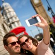 Tourists taking a picture in London — Stock Photo