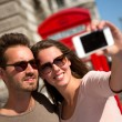 Couple taking self portrait — Stock Photo #12947589