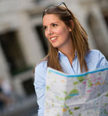 Lost woman with a map — Stock Photo