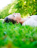 Woman relaxing at the park — Stock Photo
