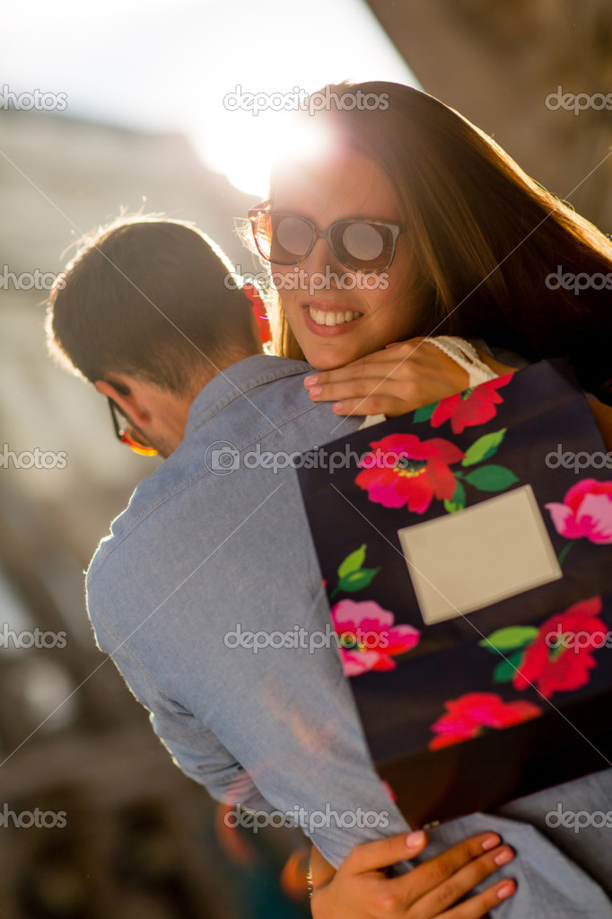 Happy woman thankful for her present hugging her boyfriend — Stock Photo #12947594
