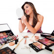 Woman doing her makeup - Stock Photo