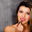 Stock Photo: Woman wearing lipstick