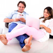 Couple relaxing at home - 