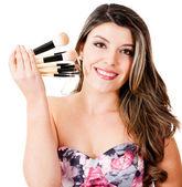 Mulher com pincéis de maquiagem — Fotografia Stock