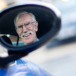 Senior man driving a car  — Foto Stock