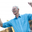 Stock Photo: Excited senior man