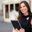 Stock Photo: Business woman holding a folder