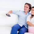 Couple relaxing at home watching tv  — Stok fotoğraf