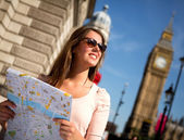 Woman sightseeing in London — Stok fotoğraf