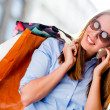 Stock Photo: Shopping woman on the phone