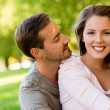 Romantic couple at the park — Stock Photo