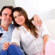 Couple holding a remote control — Stock Photo