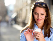 Woman sending a text message — Stock Photo