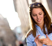 Woman texting on her phone — Stock Photo