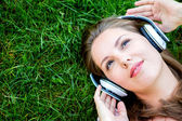 Woman listening to music — Stok fotoğraf