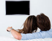 Couple watching tv at home — Stock Photo