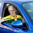 Happy man driving a car - Zdjęcie stockowe