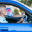 Elder man driving a car — Stockfoto