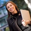 Business woman carrying a laptop — Stock Photo