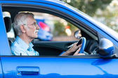 Elder man driving a car — Stock Photo