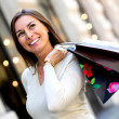 Stock Photo: Thoughtful female shopper