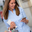 Shopping woman texting - Stock Photo