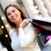 Thoughtful female shopper — Stock Photo