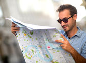 Lost man with a map — Stock Photo