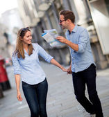 Tourists holding a map — Stock Photo