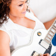Woman playing guitar — Stock Photo