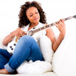 Woman playing guitar - Stockfoto