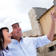 Stock Photo: Happy couple buying a house