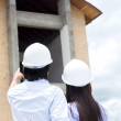 Couple looking at their new house — Stock Photo #13471587