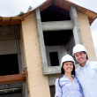 Foto Stock: Couple building their dream house