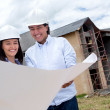 Stock Photo: Couple looking at blueprints