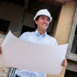 Engineer holding blueprints — Stock Photo