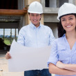 Stockfoto: Couple at a construction site