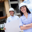 Architects at a construction site — Stock Photo #13472346