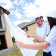 Happy couple with their new house — Stock Photo #13472370