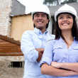 Stock Photo: Architects with a house project