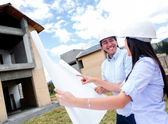 Happy couple with their new house — Stock Photo