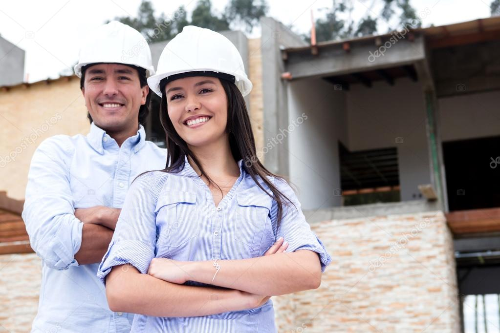 Architects building a house and wearing helmets  — Stock Photo #13472382