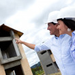 Civil engineers pointing at house — Stock Photo #13495055