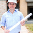 Stock Photo: Architect holding blueprints