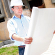 Civil engineer looking at blueprints — Stock Photo #13495058