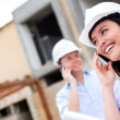 Stock Photo: Engineers talking on phone