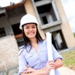 Civil engineer with blueprints - Stock Photo