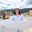 Stock Photo: Civil engineer holding blueprints