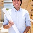 Architect holding blueprints — Stock Photo #13495770